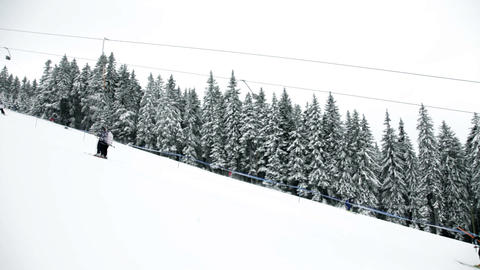Idyllic ski slope and cableway with people Footage