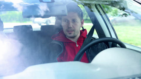 Man Driving Car And Talking To Passenger stock footage