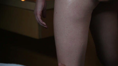 Applying skin cream to legs for massage Footage