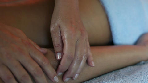 Therapist hands doing professional massage on woma Footage