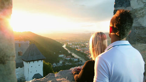 Young Couple Enjoying Romantic Sunset View From Ol stock footage