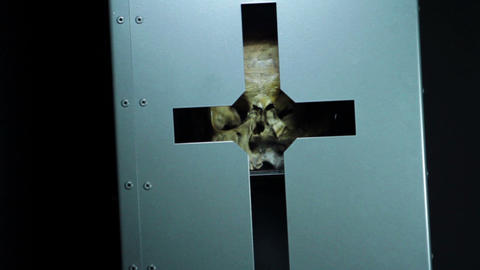 Close up of skull in a box with engraved cross Footage