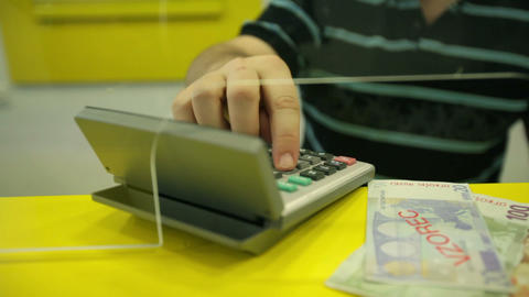 Banker behind the glass counting Euro money Footage