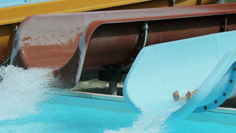 Side shot of waterslide while kids sliding down Footage