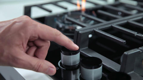Hand setting the gas cooker in kitchen Footage