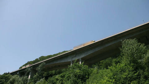 Driving below the highway with huge trees under Footage