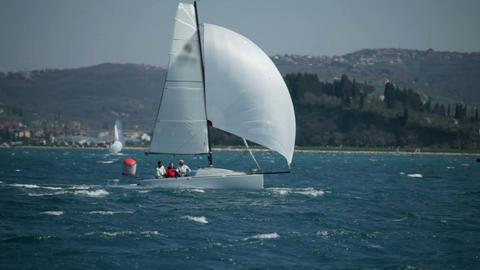 Team of sailors on sailboat speeding on sea at win Footage
