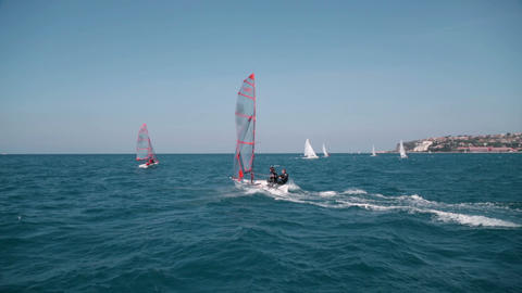 Small sailboat speeding around the sea at clear we Footage