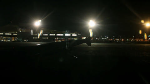 Airport at night from airplane window Footage