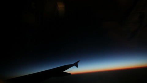 Passenger view from airplane while flying at sunri Footage