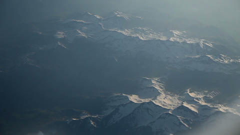 Mountains and landscape from airplane window Footage