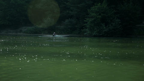 Morning shot of kayaker rowing through lake Footage