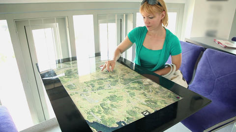 Woman exploring map on touch screen table Footage