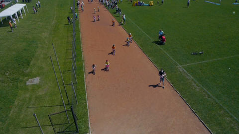 Children competing in bicycle race shot from sky Footage