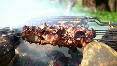 Loopable cooking of shish kebab or shashlik outdoors.... Stock Video Footage
