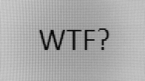Typing WTF? and Where? words on BW PC screen Stock Video Footage