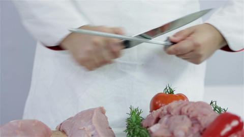Sharpening knife to cut turkey meat Footage