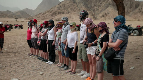 Tourists fully prepared for safari stand in line w Footage