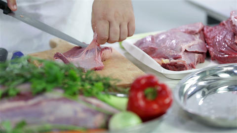 Close up on cutting red meat skin and fat Footage