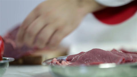 Cook Arrainging Cuts Of Red Meat On Aluminum Plate stock footage
