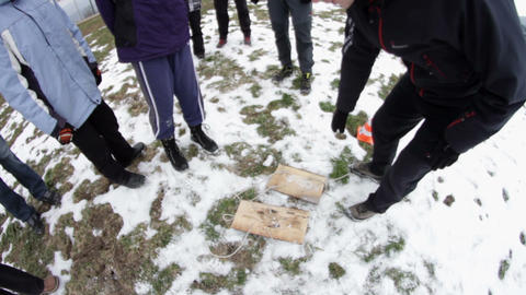 People try out wooden pads made for walking on sno Footage