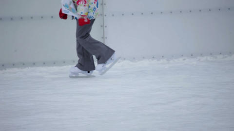 Kid walking on the skates dressed in colorful wint Footage