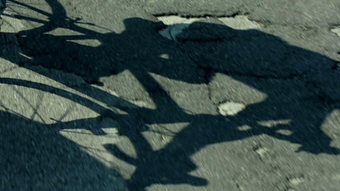 Semi close shot of cyclist shadow on concrete road Footage