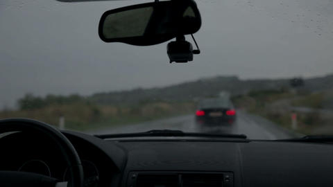 Windscreen wipers are removing rain while driving  Live Action
