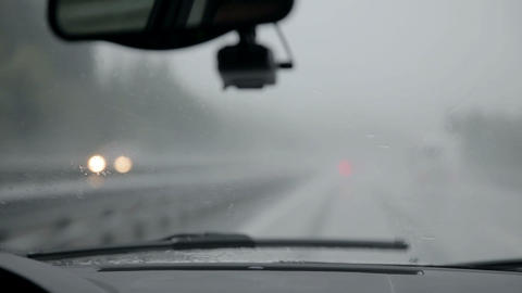 Windscreen wipers removing rain at semi-fast speed Live Action
