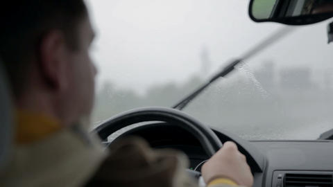 Car wipers remove rain from windscreen at fast spe Live Action