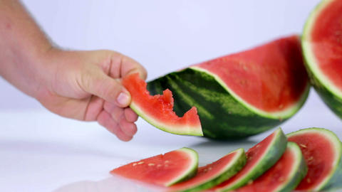 Slice of watermelon eaten away bite by bite Footage