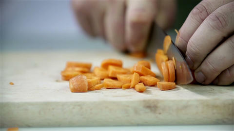 Cutting carrot with kitchen knife Footage