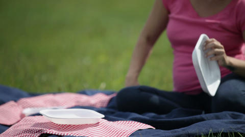 Shallow focus of woman preparing the picnic meal Footage