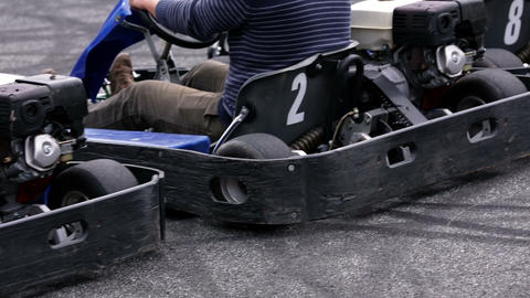 Go-kart drivers shot from the back right at the st Footage