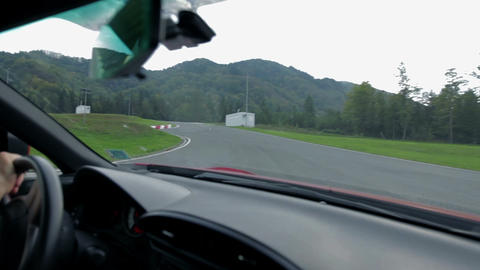 Driving hastly on a racing track shot from inside  Footage