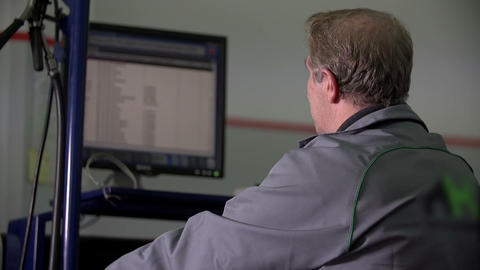 Mechanic checking out cars statistics and data Footage