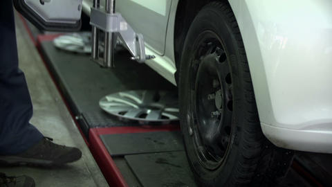 Mechanic undocks a part fastened to the tire Footage