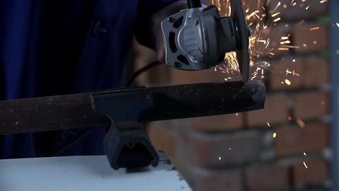 Sliting metal tube wit a metal grinder Live Action