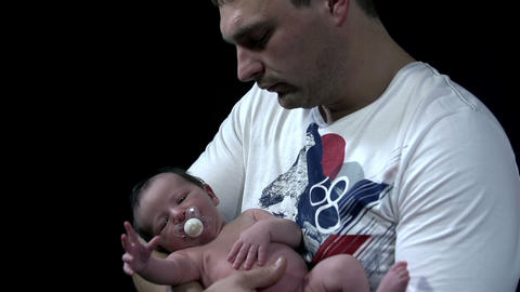 Father holds the baby in his arms Footage