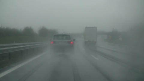 Hazy windscreen with activated wipers Footage