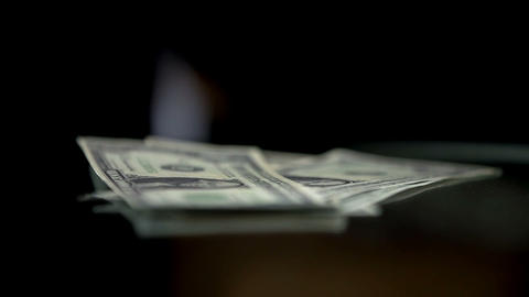 Detail Of Putting Down The Paper Money stock footage