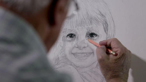 Artist draws a small girl on canvas shot behind hi Footage