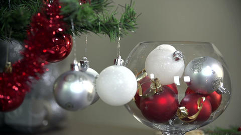 Close up on Christmas ornaments falling beside dec Footage