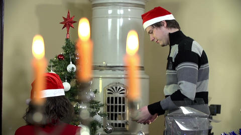 Couple beside the fireplace decorating Christmas t Footage