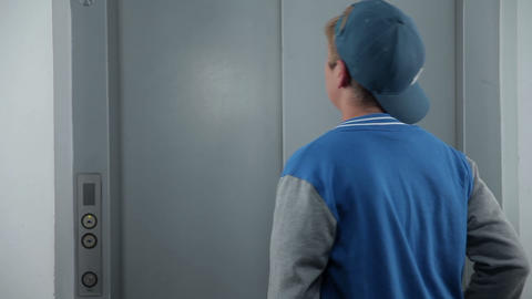 Boy waits for an elevator shot from behind Footage