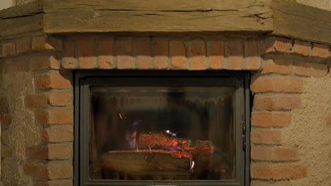 Indoor fireplace with glassy firewall Stock Video Footage