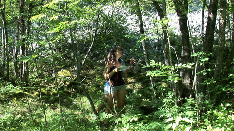 Guy joins a girl who wanders through the forrest w Footage