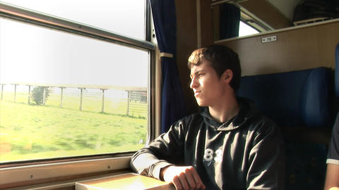 Boy stares out of the window from an old moving tr Footage