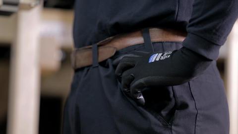 Lower body of car mechanic in work uniform Footage