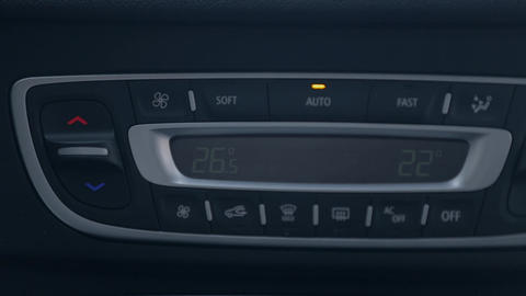 Man changing radio channel on the car radio Live Action